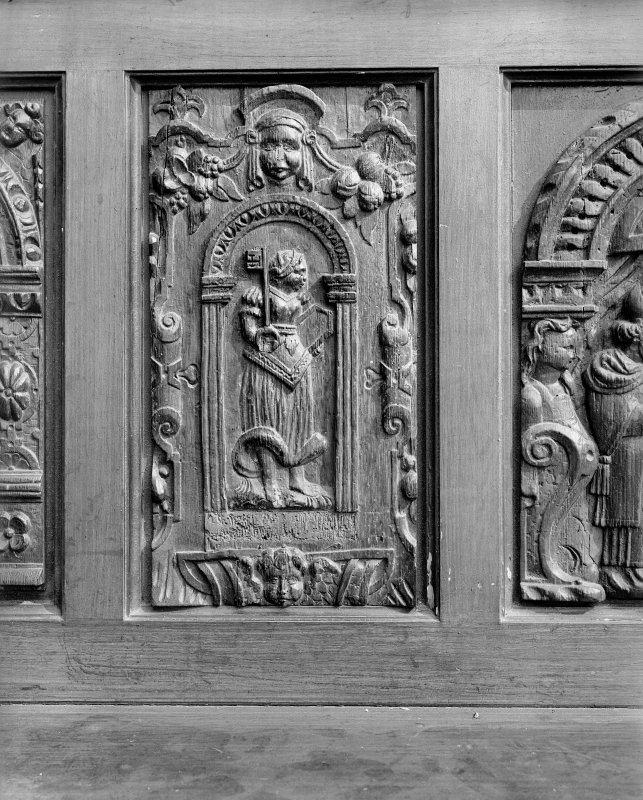 Interior. Detail of carved panel on wooden seat