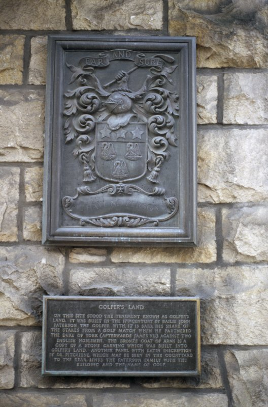View of coat of arms and inscription panel on wall.
