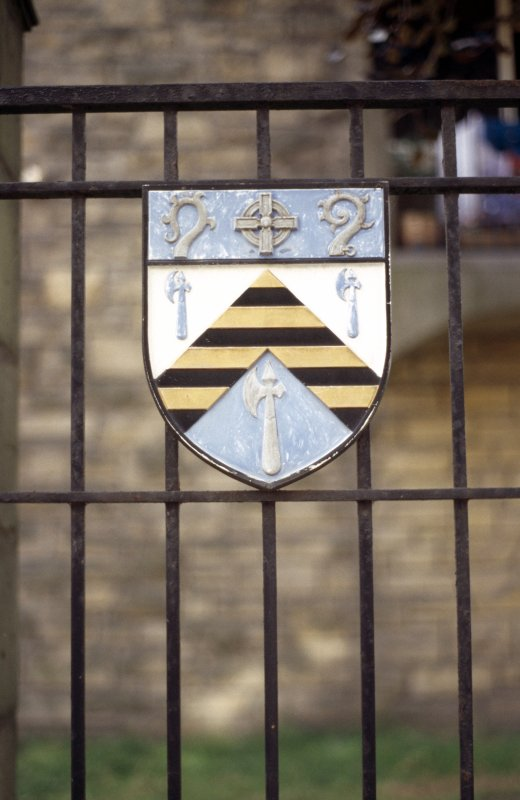 View of shield attached to gate outside Reid's Court.