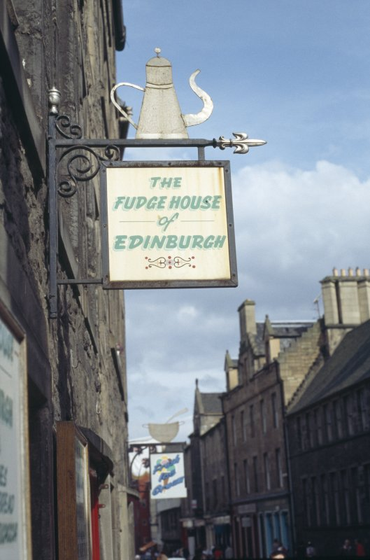 View of shop sign attached to bracket, 197 Canongate.