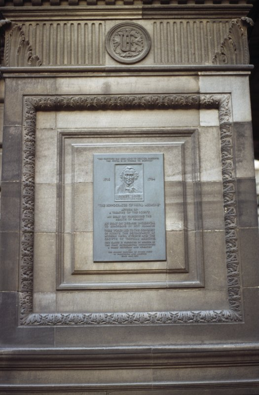 View of James Lind Memorial Plaque, on architectural panel at side of carriage entrance to Medical School.