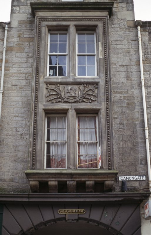 View of heraldic shield, above first floor windows above entry to Sugarhouse Close.