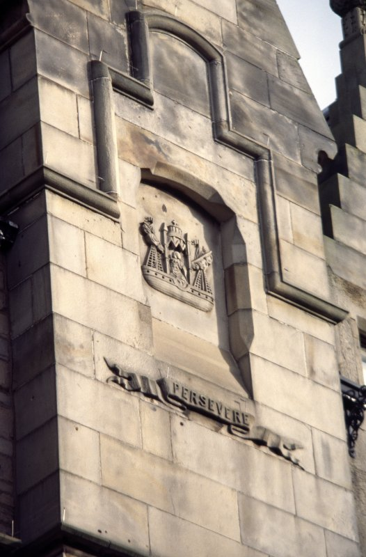 View of carved coat of arms of Leith, on chimney breast at No.58 Bernard Street.