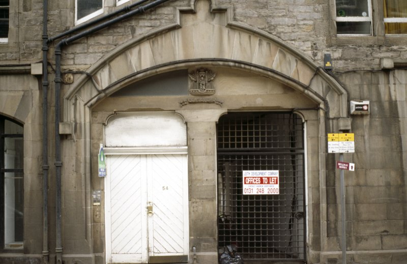 View of arched entrance to No.54 Bernard Street, showing coat of arms of Leith.