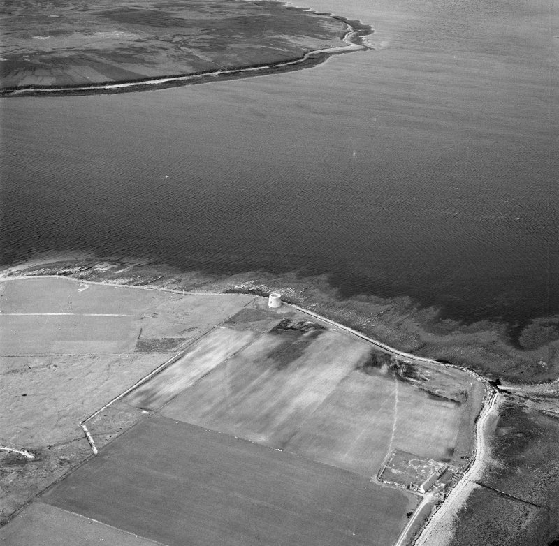 Hoy, Crockness, oblique aerial view, taken from the SW, centred on the Martello Tower and a curving linear soilmark.