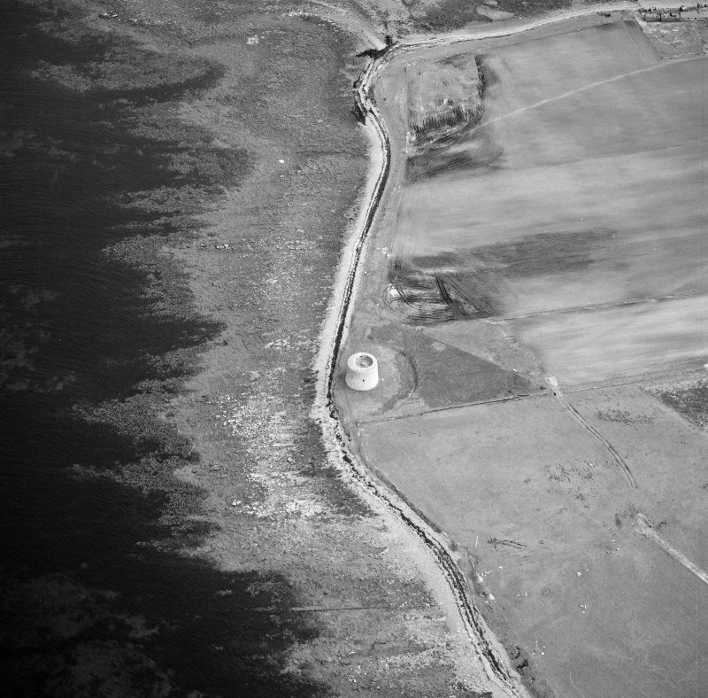 Hoy, Crockness, oblique aerial view, taken from the NNW, centred on the Martello Tower. A curving linear soilmark is visible in the centre right of the photograph.