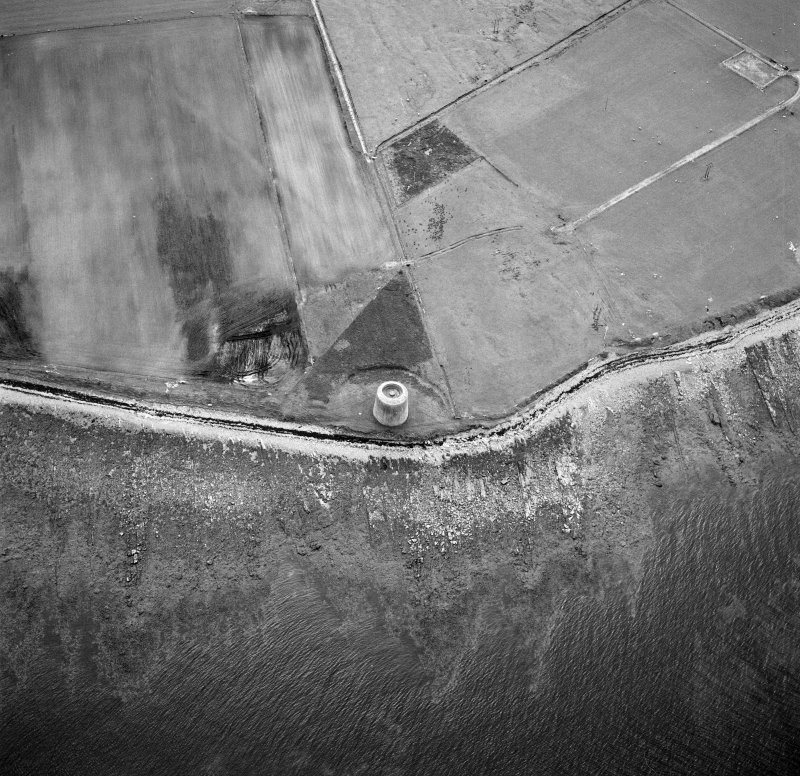 Hoy, Crockness, oblique aerial view, taken from the ENE, centred on the Martello Tower. A curving linear soilmark is visible in the top left hand corner of the photograph.
