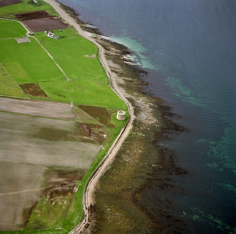 Hoy, Crockness, oblique aerial view, taken from the SE, centred on the Martello Tower. A curving linear soilmark is visible in the centre left of the photograph.