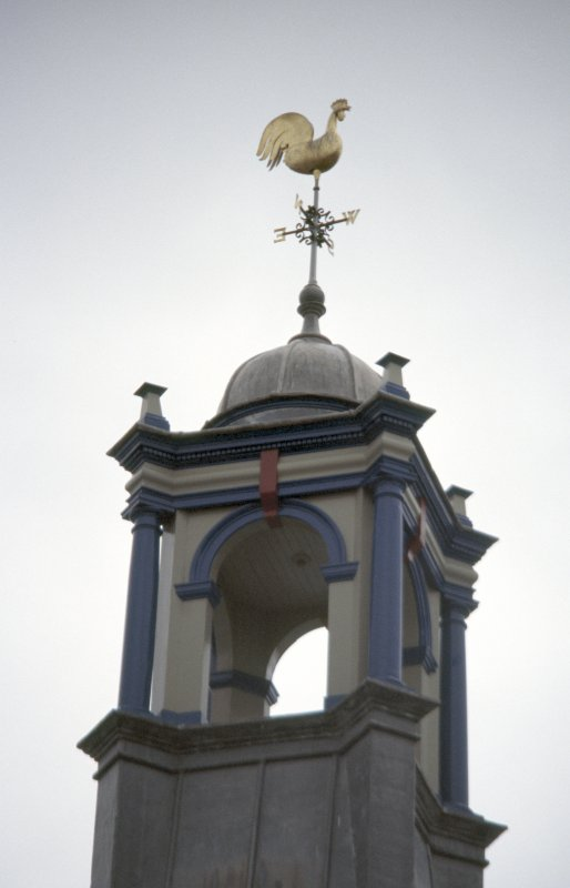 View of cockerel weather vane at top of tower.