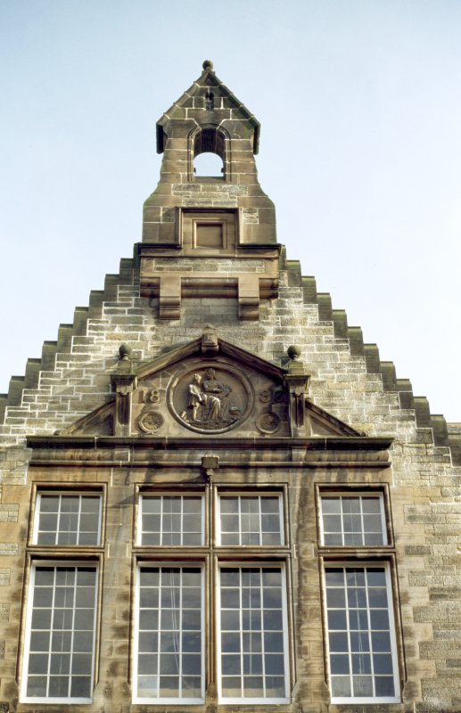 View of carving of 'Education', in gable of Canongate facade.