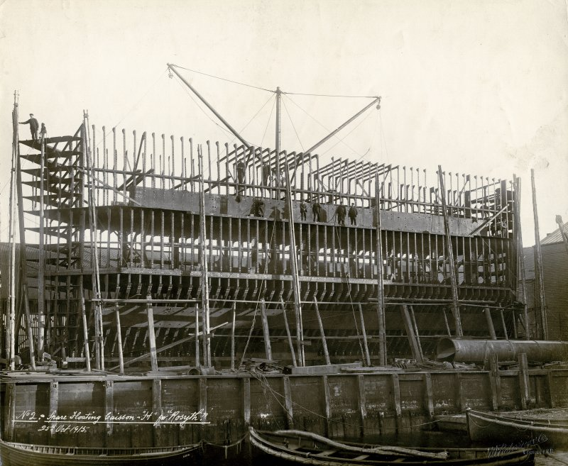 View of caisson  Titled: 'No 2 spare floating caisson 'H' for Rosyth'. Stamped on back: 'Sir William Arrol & Co Ltd'; 'The Clyde Shipbuilding & Engineering Co. Ld, Port Glasgow; Engineers & Boilermakers Shipbuildiers 30 Oct 1915. Repairing dock'.