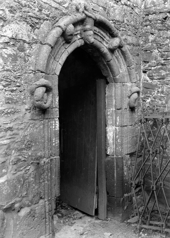View of arched doorway with carving above.