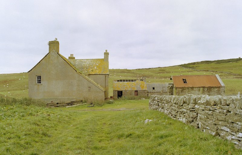 Farmhouse and outbuildings from east