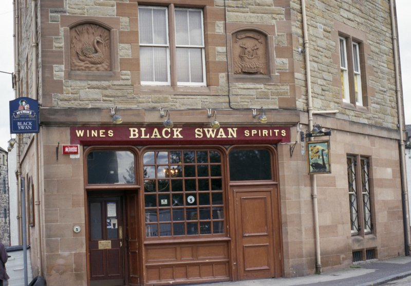 View of the Black Swan bar, showing panels carved with a swan (left) and the arms of Leith (right).