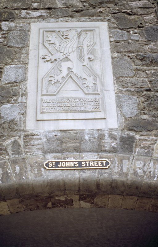 View of carved panel, on wall above St John's Street.
