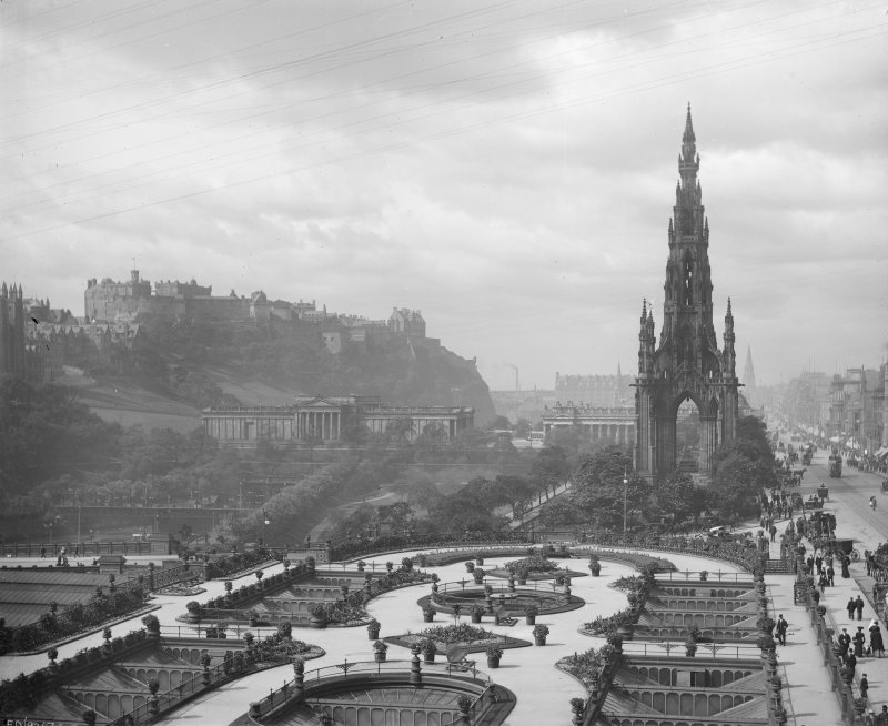 View from east showing Scott Monument, part of Princes Street, the Mound, Castle and Waverley Gardens
