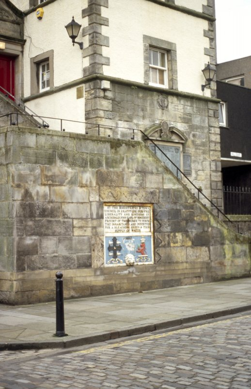 View of Tolbooth, showing drinking fountain on wall of steps, and arms of Queensferry and war memorial on lower part of tower.