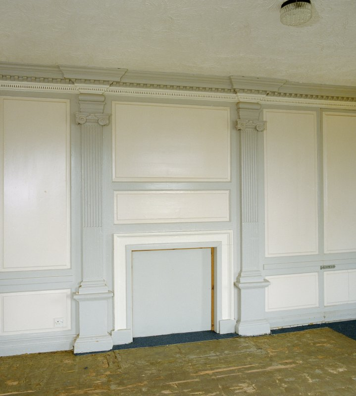 Interior, ground floor, south west room, view of fireplace and flanking pilasters