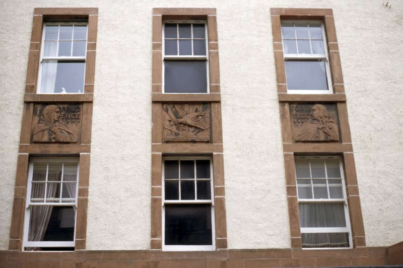 View of panels betwen windows, above entrance to 1940s extension to Leith Hospital Nursing Home (now flats).