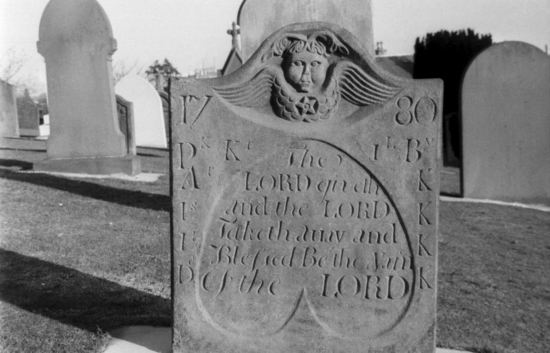 Detail of gravestone dated 1780 at St Regulus' burial ground, Monifieth.