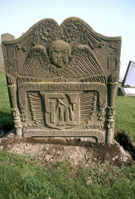 General view of gravestone of May Duff, 1762. Double rosette with double torches of Life and Death. Winged Soul over ribband insc: 'After Death Life. Hors Est Boni Viri Natalis'. Shield with the tools of a mason (setsquare, folding ruler, dividers chisel, hammer and mallet). Insc: 'D.M S.D'.