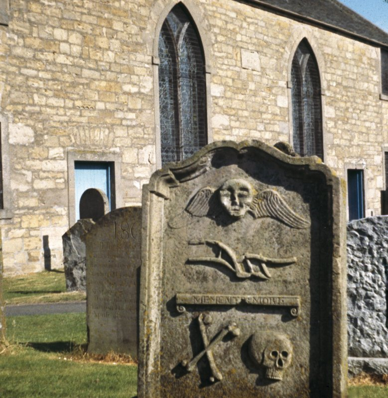 View of the gravestone of William Frazer, d. 1756. Winged soul, plough, 'Memento Mori' ribbon, crossed bones and skull at Dunning, St Serf's Church and Churchyard.