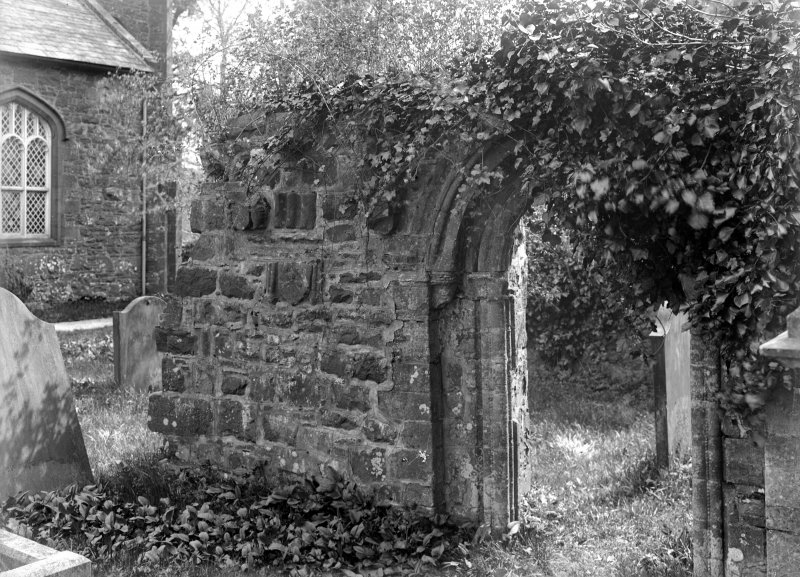 View of roundheaded doorway from NE.