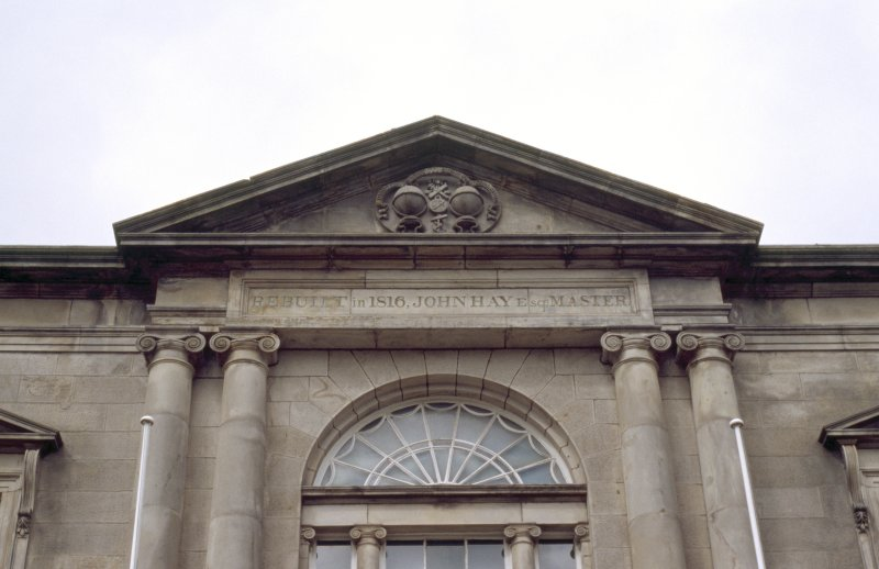 Detailed view of main facade of Trinity House, showing coat of arms in pediment.