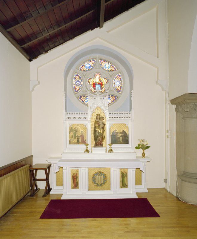 Interior. E side chapel, view of altar from N
