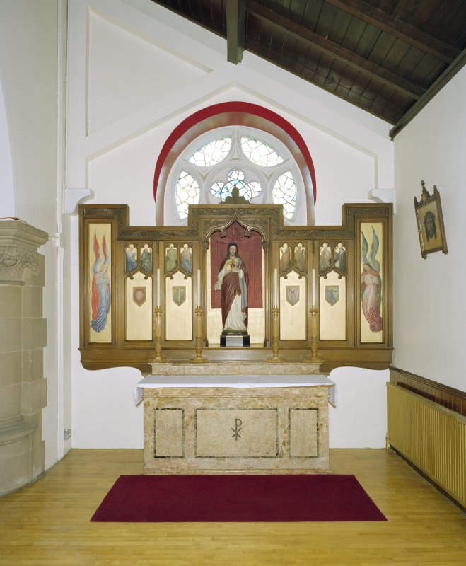 Interior. W side chapel, view of altar from N