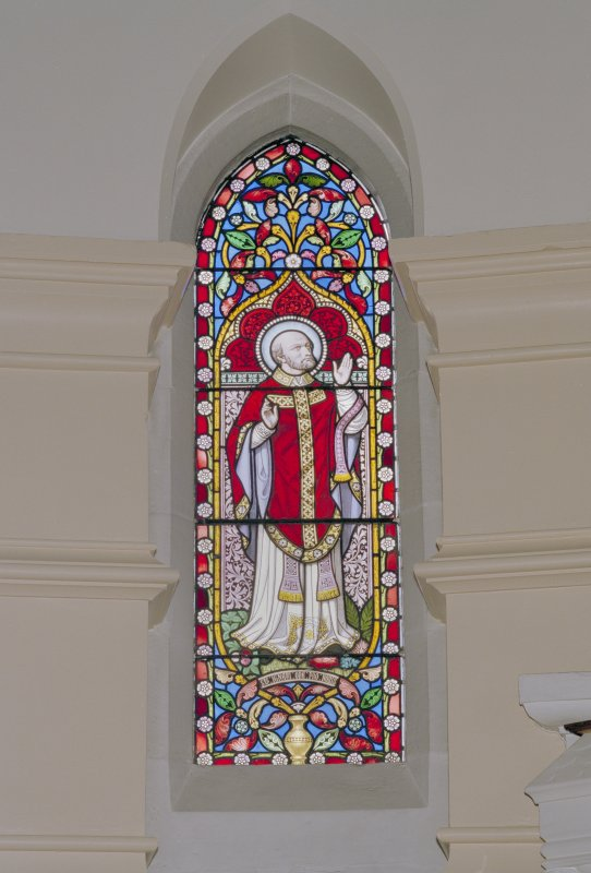 Interior. Chancel, detail of stained glass window to St. Ignatius