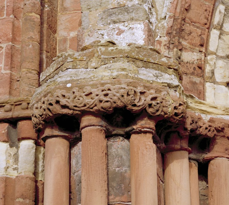 Main W doorway, detail of capitals on N side