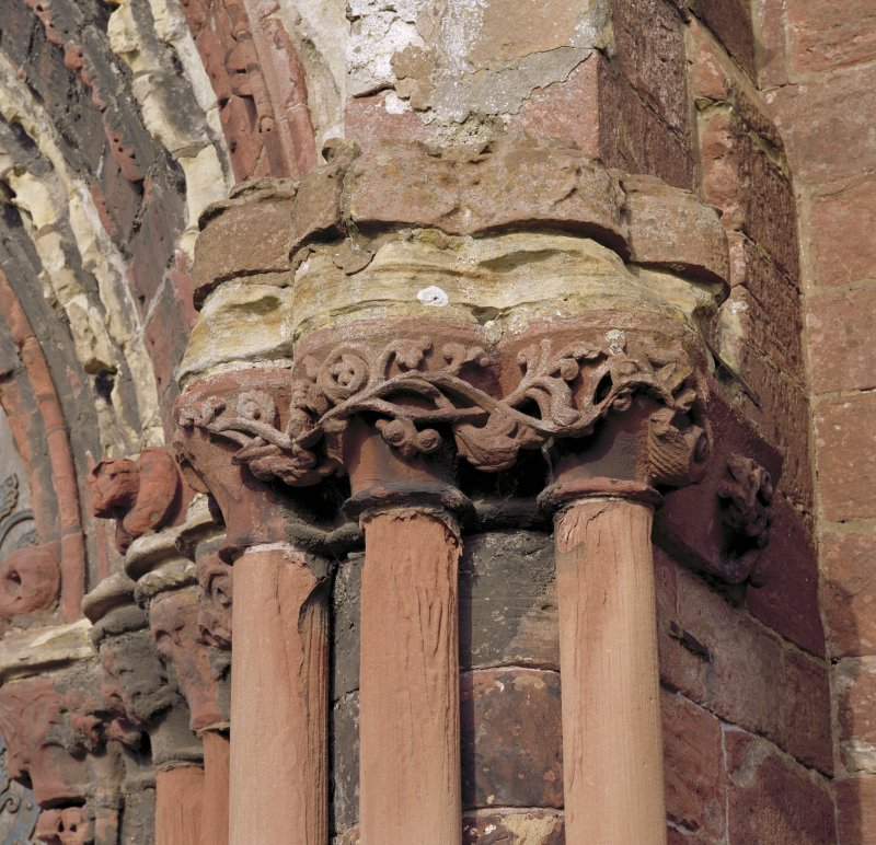 Main W doorway, detail of capitals on S side