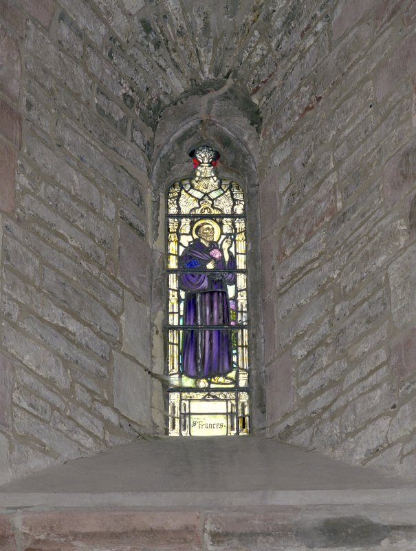 Interior.  Nave, N aisle, 1st bay from W, detail of stained glass window (St. Frances)