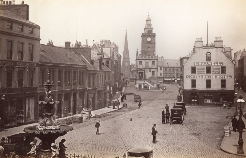 Historic photograph showing general view from south of Dumfries High Street including Midsteeple.