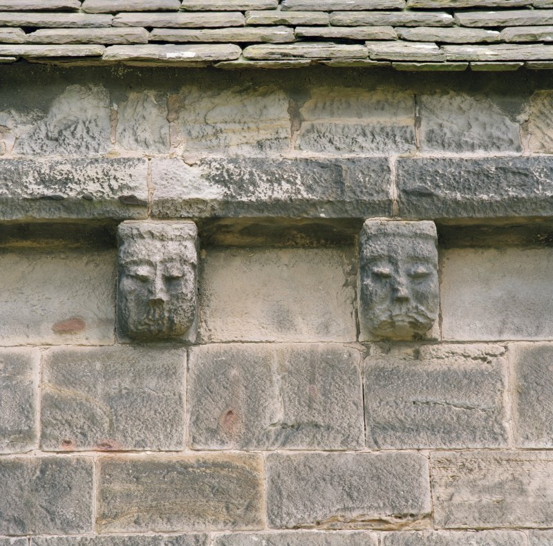 Detail of two corbels on south wall of chancel