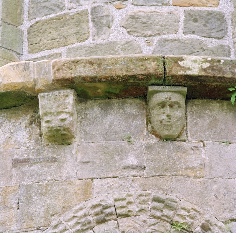 Detail of two corbels on apse
