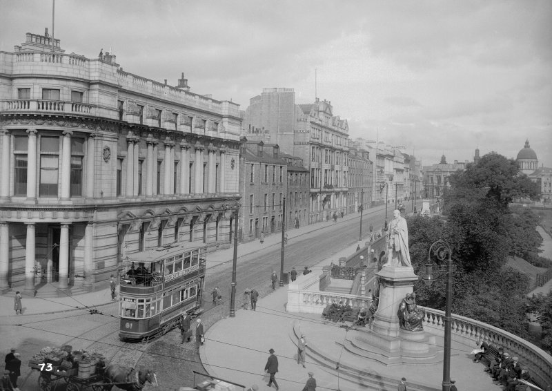View of Union Terrace, Aberdeen, with a tram including statue of King Edward VII.