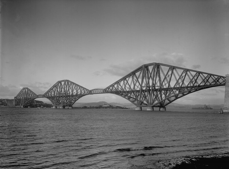 General view of the bridge from the South West shore.With HMS Nelson or Rodney on horizon.