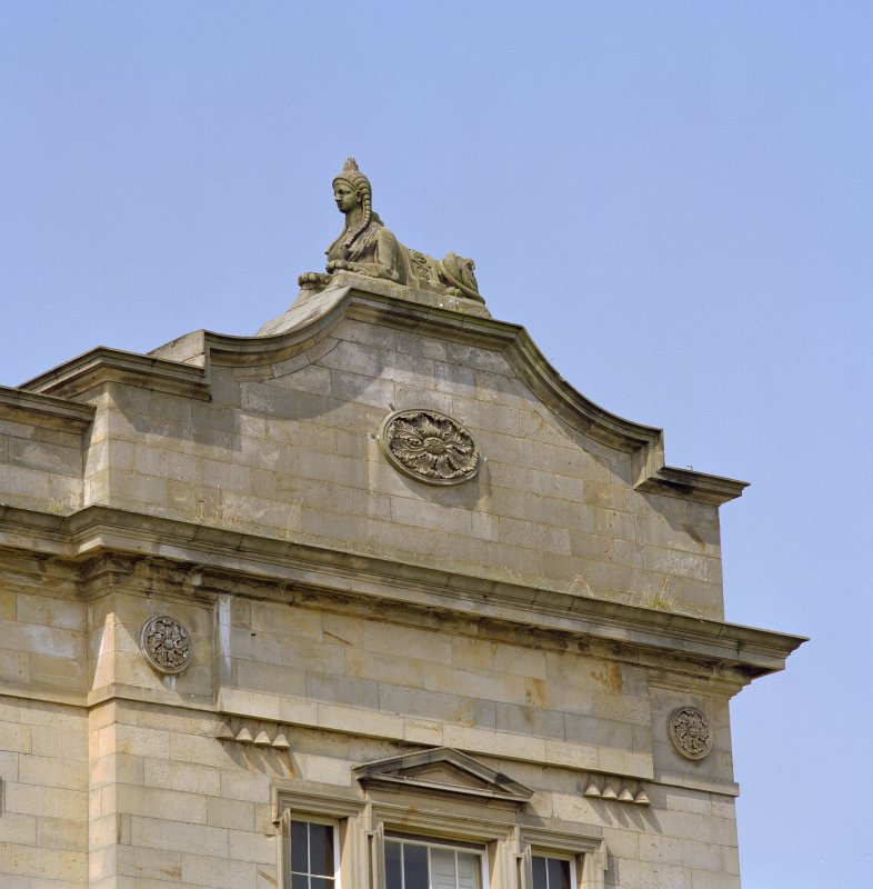 Detail of carved figure of sphinx above pediment at north end of east front