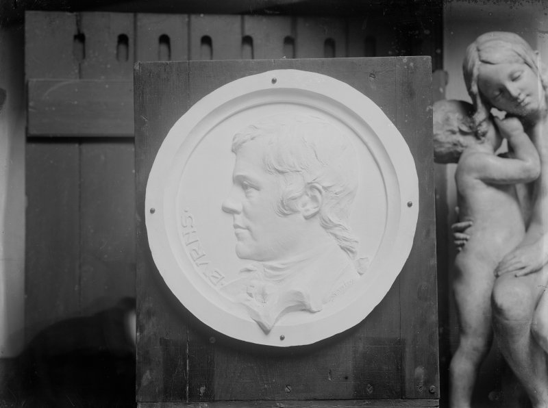 Roundel of Robert Burns medallion in situ in the artist's studio.