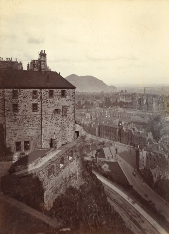 Historic photograph. View of part of the Naval and Military Museum and outer wall taken from the New Barracks with views to the Grassmarket and Arthur Seat. Mount signed: 'Thomas Ross' and inscribed: 'Edinburgh Castle. December 1912'.