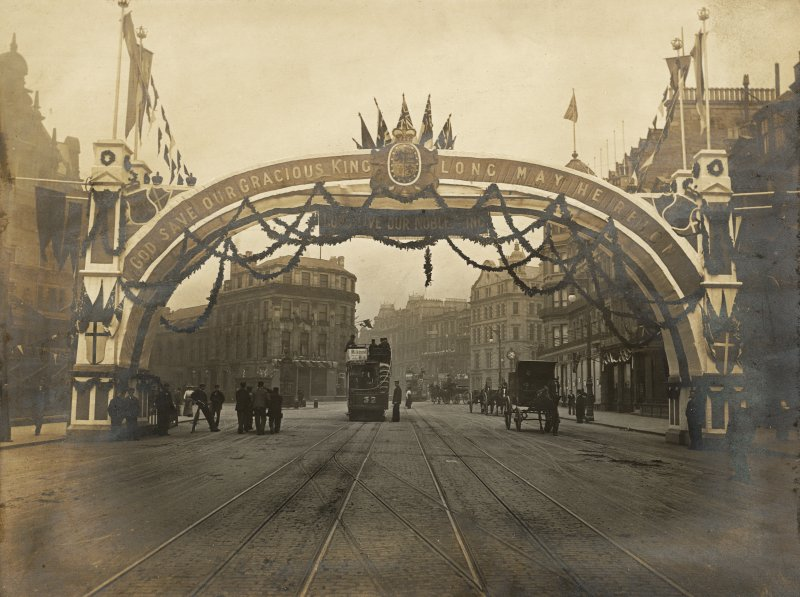 Copy of historic photograph showing view of triumphal arch at W end of Princes Street with the lettering; 'GOD SAVE OUR GRACIOUS KING LONG MAY HE REIGN' for the coronation of Edward VII.