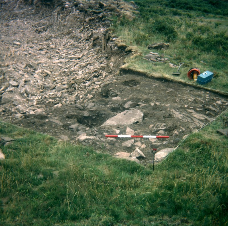 View from N of paving above pits during excavation; photographic scale in 200mm divisions