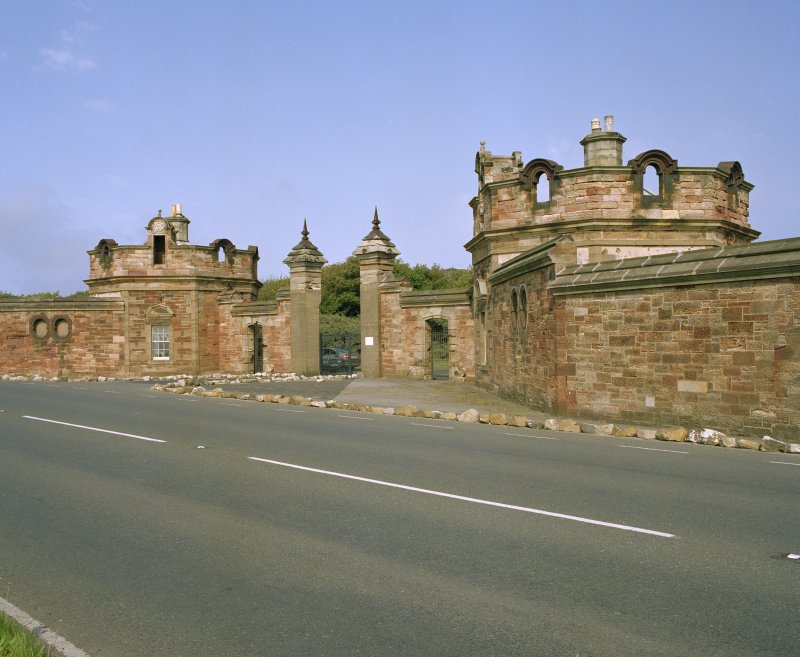 General view of lodge and gatepiers from south west