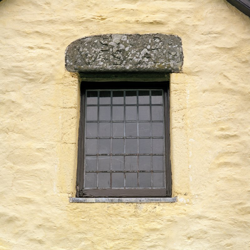 Detail of window in E gable with inscribed lintel above