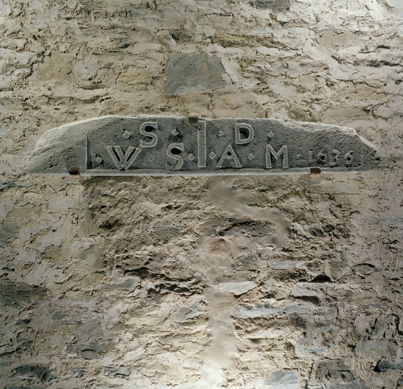 Interior, detail of date lintel mounted on W wall