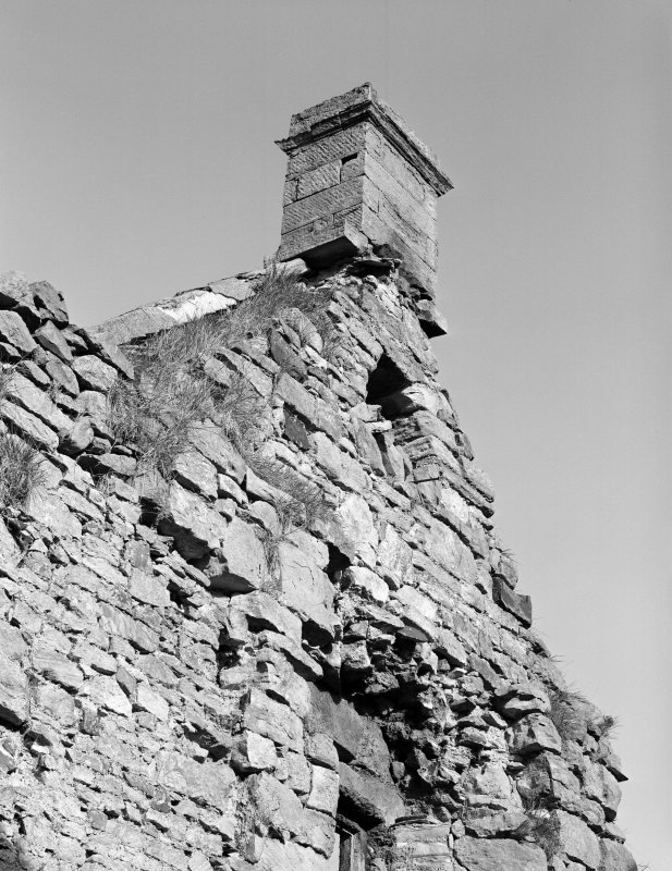 View of corbelling of former angle turret on S wall.