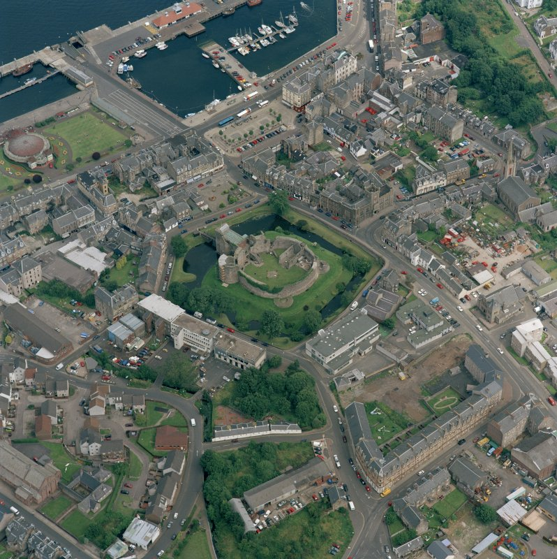 Oblique aerial view of Rothesay centred on the remains of the castle and chapel, taken from the SW.