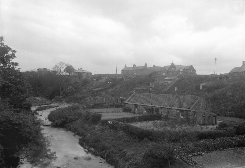 General view of village from East on bridge on Kirkgate.